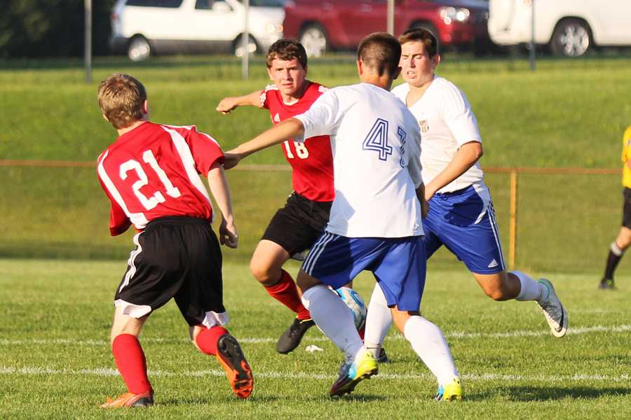 Nikola Vuckovic(11) runs to help Colton Meyers (9) get the ball from Portage players. The boys beat Portage with a score of 6-0.