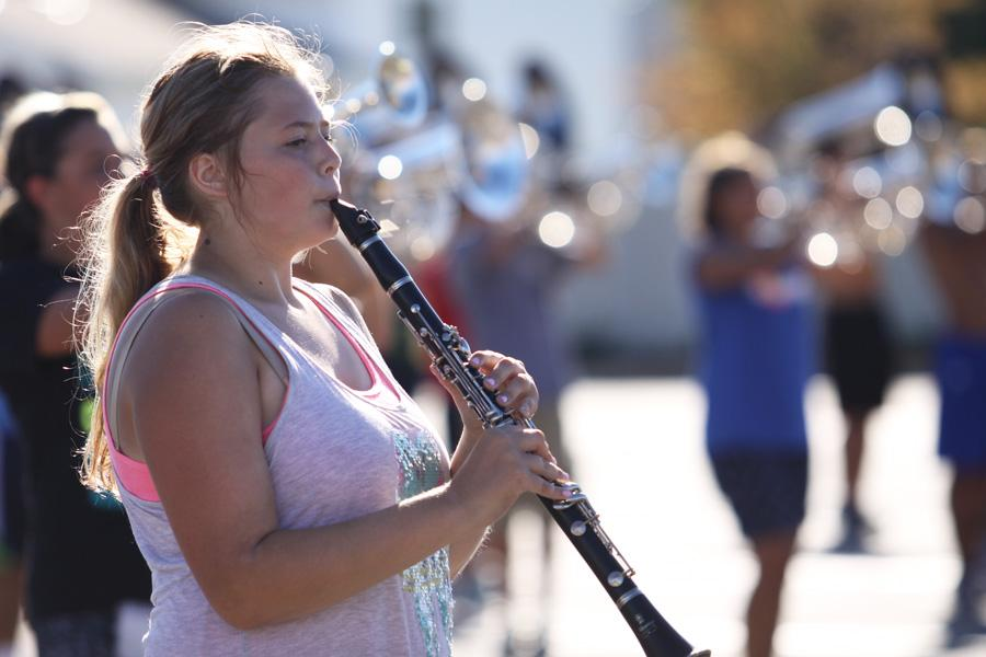 Bailey Kearschner (9) practices the clarinet during practice. The band practices outside at least twelve hours each week, weather permitting.