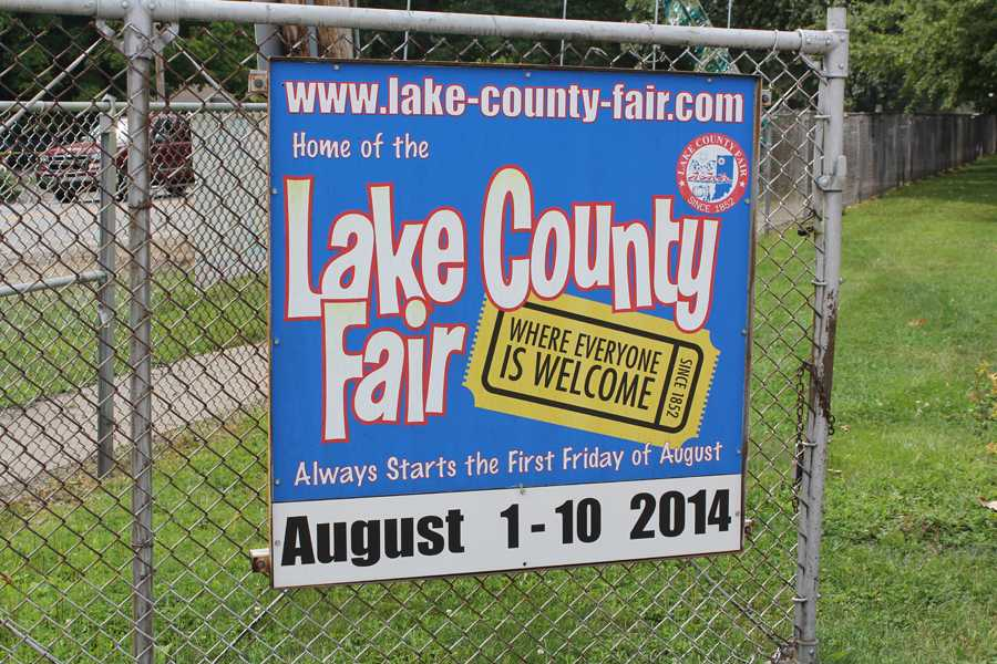 The Lake County Fair sign hangs on the fence of the entrance to welcome visitors. The Lake County Fair ran from 9 in the morning to midnight every day.