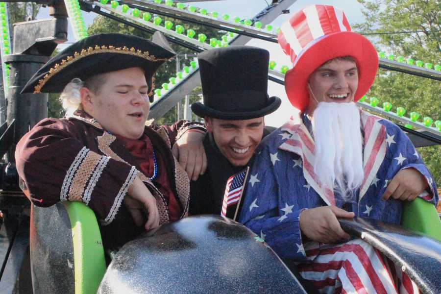 Jackson Delise (11), Brett Balicki (11) and Nicholas Kiepura (12) ride on the new rides at the St. John Festival. They volunteered to dress up as historical figures on the fest's patriotic day.