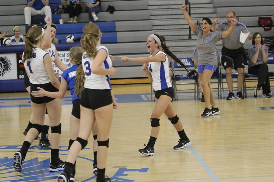 The team celebrates after Victoria Gardenhire (11) gets a kill. The team played very well offensively in the match against LaPorte.