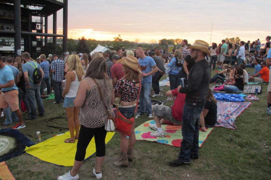 The crowd anxiously waits for Jason Aldean to take the stage at the First Midwest Bank Ampitheatre. The show was the second to last concert to be performed on the Megaticket.