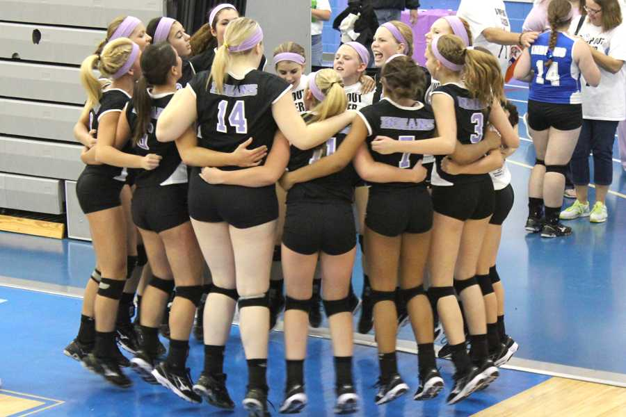 The+girls+varsity+volleyball+team+huddles+before+the+game.+The+girls+went+into+the+game+with+high+spirits.