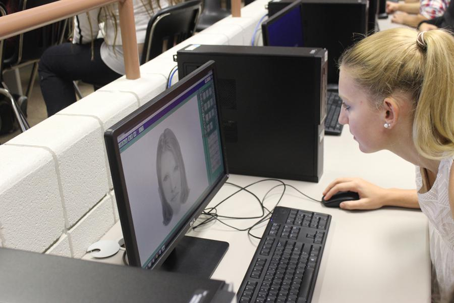 Morgan Olson (11) works carefully alone to create a replica of her image. Olson began her facial reconstruction in computer lab 9221 with the rest of Rachel Thomas's forensics science class.
