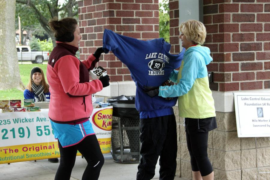 Ms. Aubria Cichocki, Math, and Sarah Berumen help Mrs. Tallent throw on another sweatshirt. The cold weather had everyone adding layers.