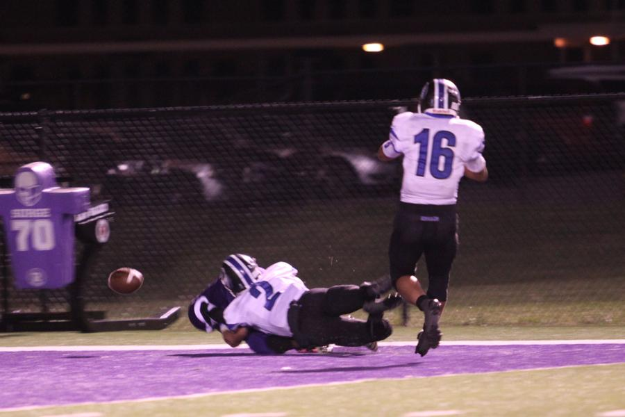 Quinn Paprocki (12) tackles a Merrillville player in the endzone. Paprocki, along with Charles Sykes (12) allowed only one touchdown against the high-powered Merrillville offense.