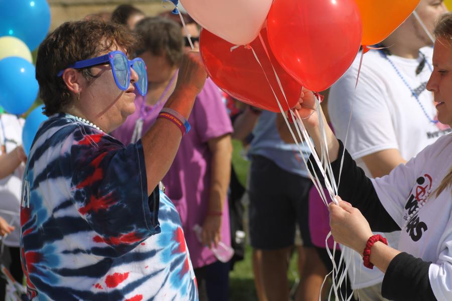 Volunteers hand out balloons at the end of the Out of  the Darkness walk at Centennial Park in Munster.  The event raised money and awareness toward the American Foundation for Suicide Prevention.