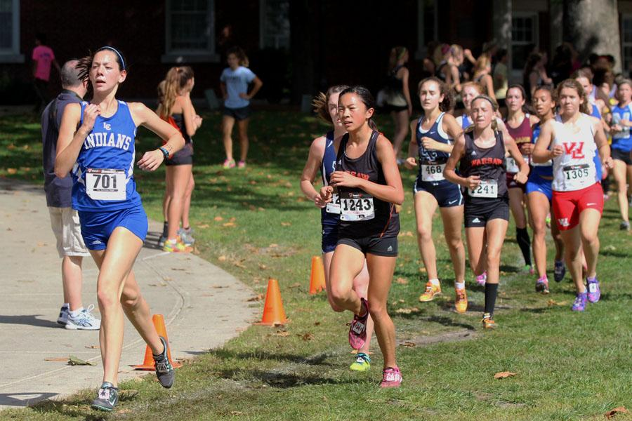 Maritza Castenada (12) leads a pack of runners at the 33rd Annual Culver Academies Cross Country Invitational.  The girls cross country team traveled to Culver, Indiana on Saturday, Sept. 27 to run at the invite.