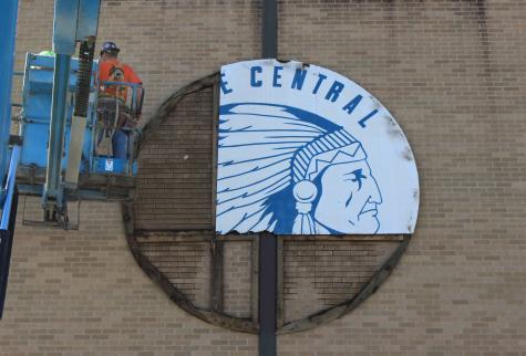 Construction workers take down the Indian Head. The Indian head was once on the front of the Field House.