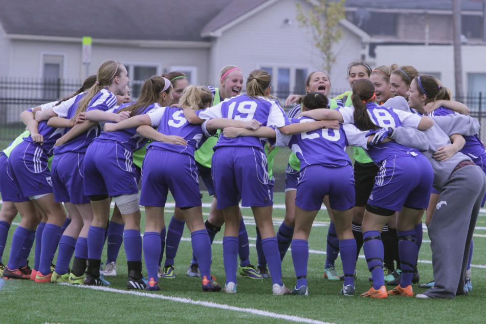 The+girls+huddle+up+before+the+game..+They+made+sure+that+their+last+huddle+together+would+be+a+special+one.