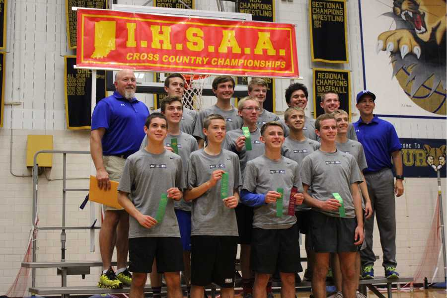 The boys display their accomplishment of fifth place overall at the New Prairie semi-state meet.  The team finished with a score of 156 points, and will advance to the state meet at Terre Haute.