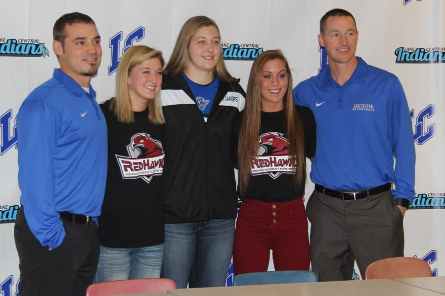 Girls+basketball+coaches%2C+Mr.+Andy+Gurnak+and+Mr.+Mark+Urban%2C+stand+proudly+next+to+their+three+players+who+signed+to+play+college+ball.+Tara+Zlotkowski+%2812%29+signed+with+Indiana+University+Northwest%2C+Lindsay+Kusbel+%2812%29%2C+Grand+Valley+State%2C+and+Gina+Rubino%2C+%2812%29+Indiana+University+Northwest.++