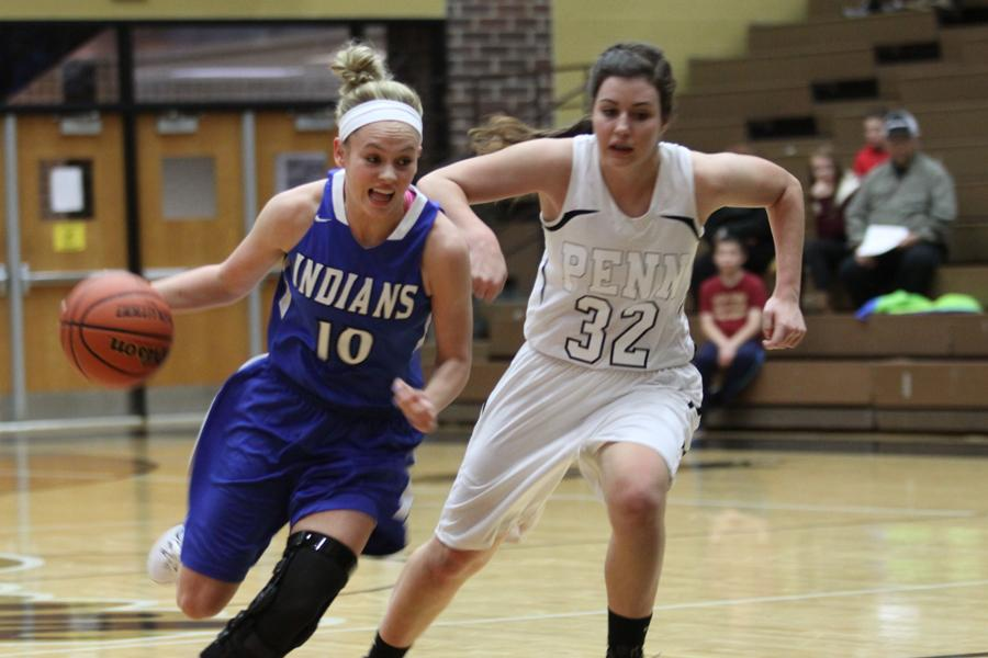 Rachel+Bell+%2811%29+drives+to+the+basket.+Bell+started+in+her+fourth+game+back+from+an+ACL+injury.