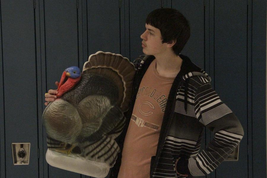 Dylan Anderson (12) poses with the famous Food Drive turkey. The turkey had been stolen, for the past two years, from its owner, Mr. Thomas Clark, History, by Ms. Terri Budlove, Business.