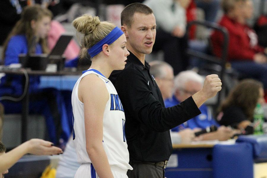 +Coach+Marc+Urban%2C+Physical+Education%2C+talks+with+Rachel+Bell+%2812%29+on+the+sideline.+Bell+contributed+two+points+to+the+Lady+Indians+victory.