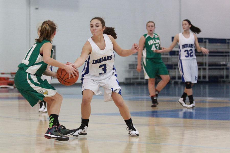 Gabrielle O'Keefe (9) sntaches the ball from a Viking player. O'Keefe played tough defense the entire game.