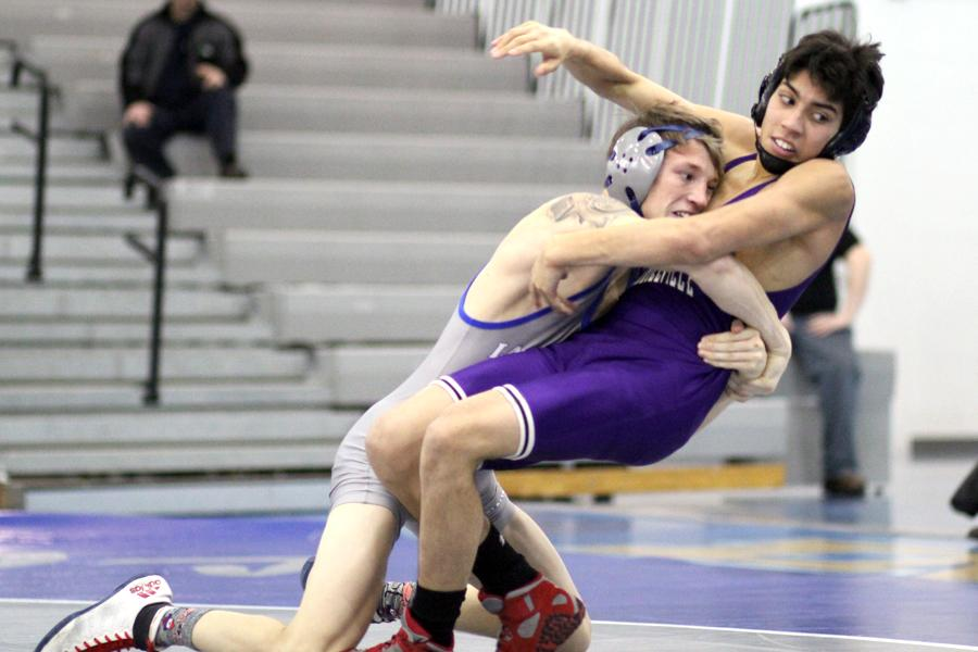 Branden+Truver+%2812%29+takes+his+opponent+down+to+the+mat.+Truver+pinned+his+opponent+and+gained+six+points+for+the+team%E2%80%99s+score.