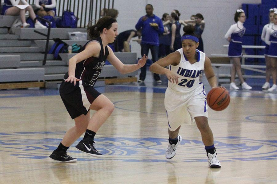 Jayla+Harvey+%2812%29+dribbles+around+a+Lowell+defender.++The+next+game+has+been+planned+to+take+place+on+Friday%2C+Jan.+23.++