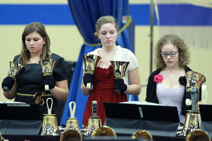 Danielle Gaines (11), Katherine Freeman (11) and Katherine Veronesi (10) play in the handbell concert on Feb. 17.  They performed with Grimmer Bells and Grimmer Middle School.