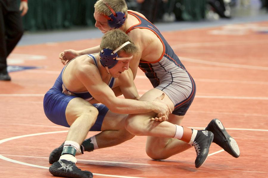 Kodie+Christenson+%2812%29+holds+on+to+his+opponent%E2%80%99s+leg.+Christenson+qualified+for+the+State+Finals+by+placing+third+at+Semi-State.+%0A