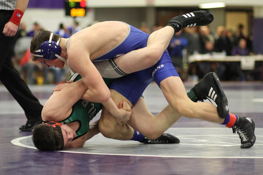 Jacob Kleimola (11) attempts to pin his Valparaiso opponent. Kleimola qualified for the State tournament and will wrestle at Bankers Life Fieldhouse next weekend.