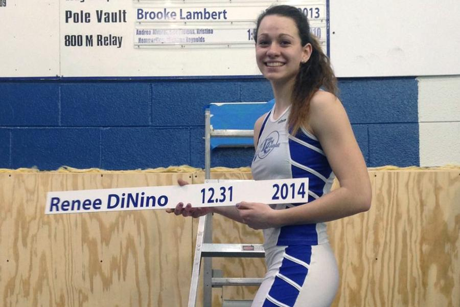 Renee+DiNino+%2811%29+displays+the+record+for+the+100-meter+dash+after+beating+the+previous+time+by+a+hundredth+of+a+second.+She+has+been+involved+in+track+since+freshman+year+and+also+runs+the+200-meter+dash+the+400x100+relay+and+the+400x400+relay.+%0APhoto+submitted+by%3A+Renee+DiNino