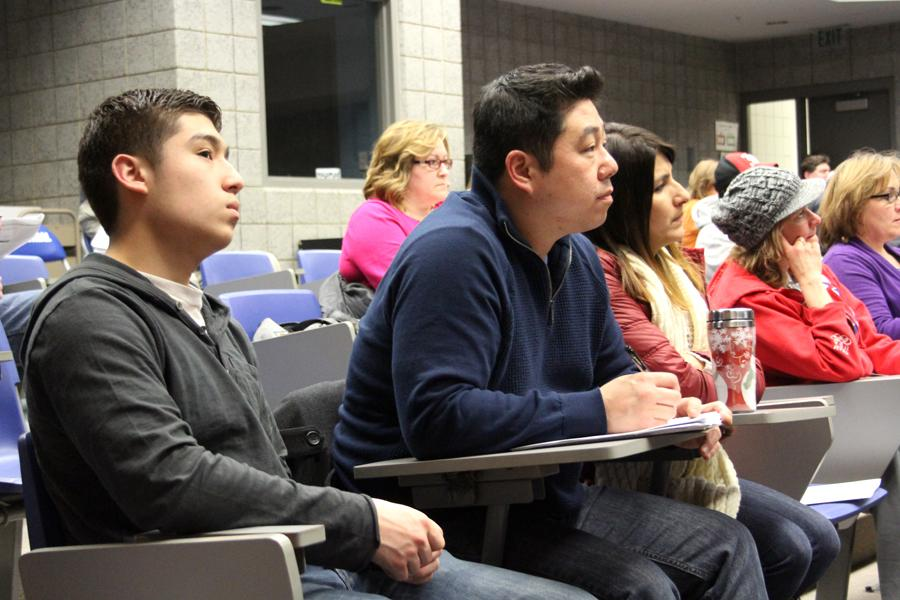 David Park (12) and his parents listen to a presentation about FAFSA. Park was one of the five students that attended the meeting.