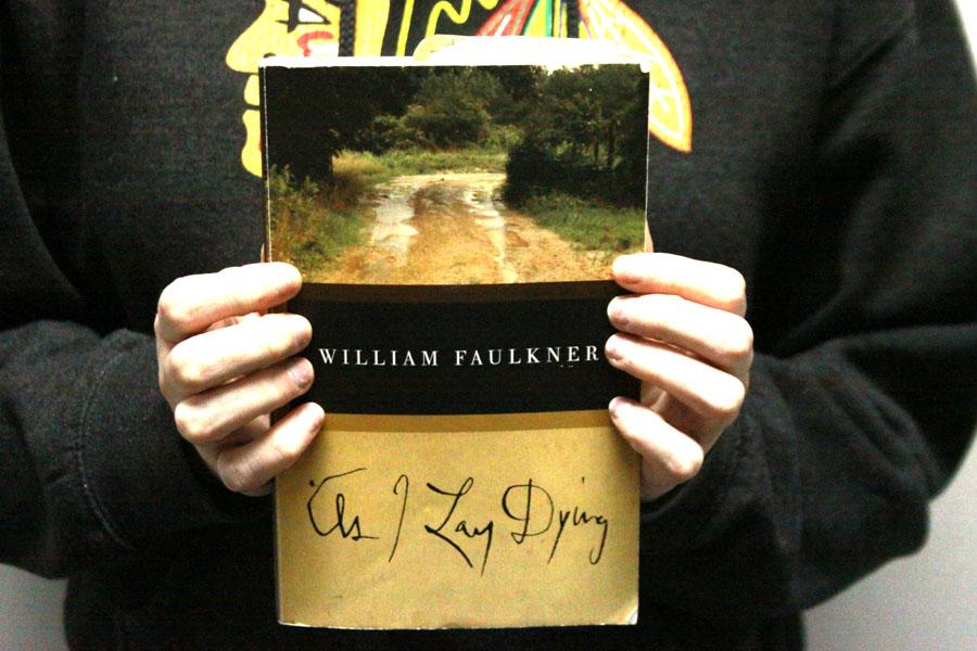 A+student+holds+her+copy+of+%E2%80%9CAs+I+Lay+Dying%E2%80%9D+by+William+Faulkner.+Students+were+assigned+this+book+to+read+for+their+AP+English+11+class.+%0A