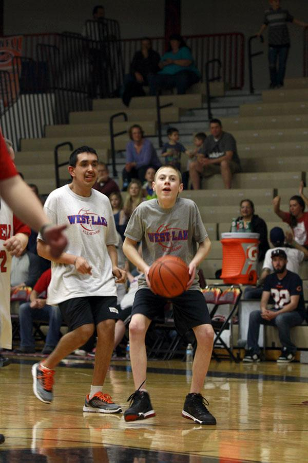 Andrew Birlson (8) takes a shot during the Special Olympic basketball game March 16.  Birlson was awarded a sportsmanship award at the end of the game.