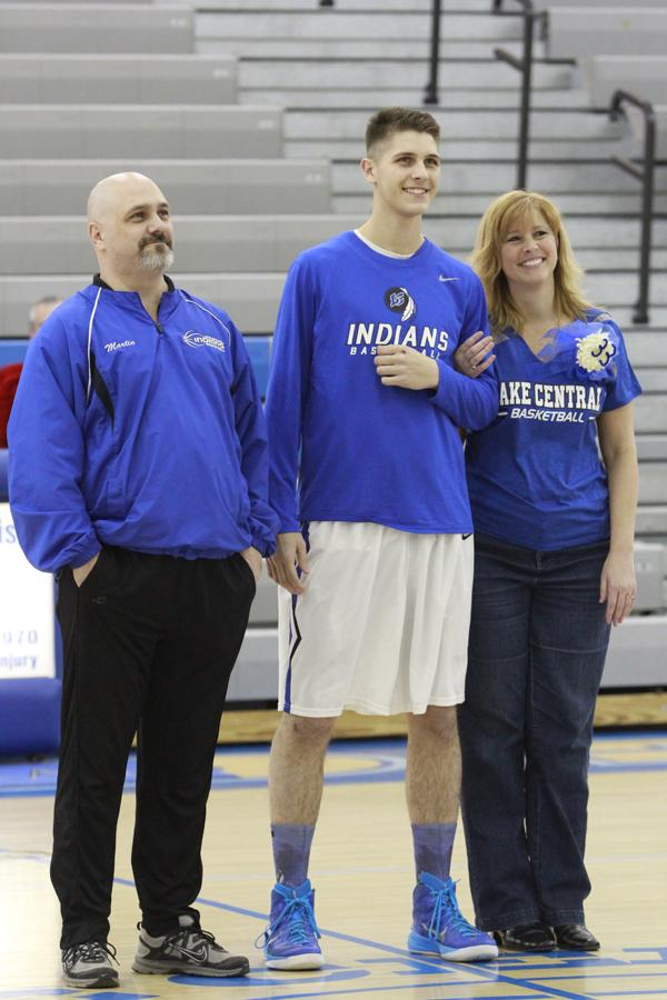 Ian+Martin+%2812%29+smiles+with+his+mom+and+dad+for+the+audience.++Martin+walked+out+on+the+gym+floor+knowing+that+his+senior+year+was+coming+to+an+end.
