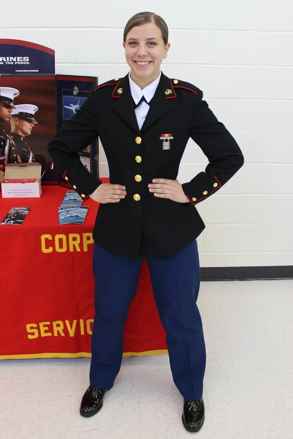 Alyssa Alfano ('14) poses at the Marine table during lunches on March 12. Alfano graduated as a junior and went on to boot camp in the fall to become a Marine.