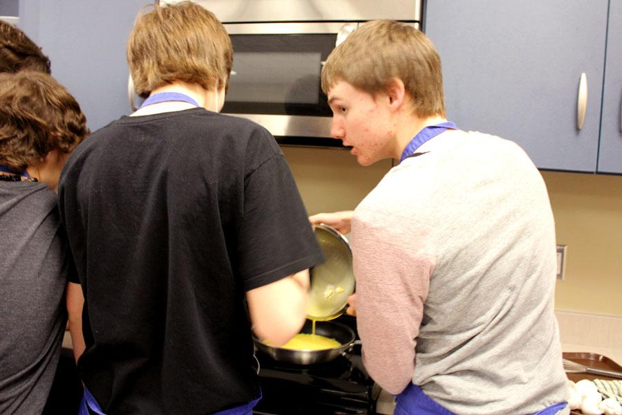 Cameron Meyers (9), Nick Doyle (9), Justin Graves (9) pour the egg yolk into the pan. They were the cooks of the group