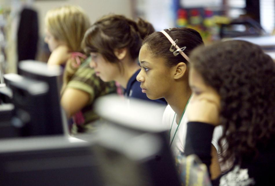 Students look at computer screens in school. Cyberbullying affected 14.8 percent of students in the year 2014.