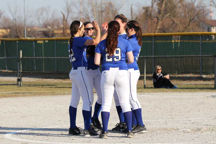 Rylee Platusic (9), Jessi Kiefor (9), Selena Michko (9), Alexa Pinarski (9)  and Sydney Dinan (9) go in for a group high-five to congratulate each other on another run.  The team won by a landslide with a final score of 12-1.