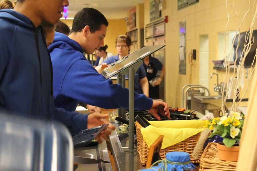 Alexander Bielawski (11) serves himself in the new, healthy lunch line. The two lunch lines have offered students a healthier option by giving them the opportunity to serve themselves.