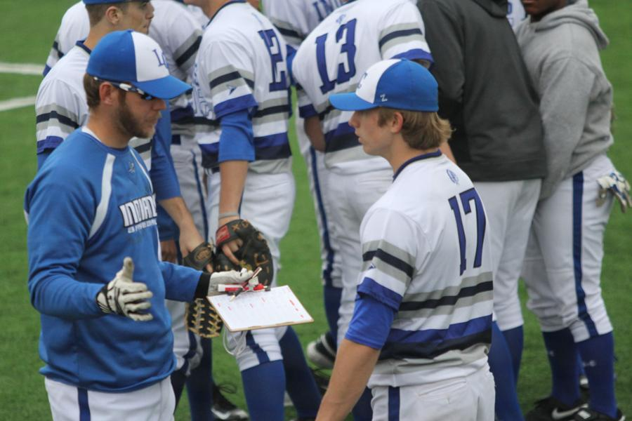 Assistant+coach+Brett+Summers+gives+advice+to+starting+pitcher+Matthew+Litwicki+%2810%29.+Litwicki+pitched+every+inning+except+for+the+last.+