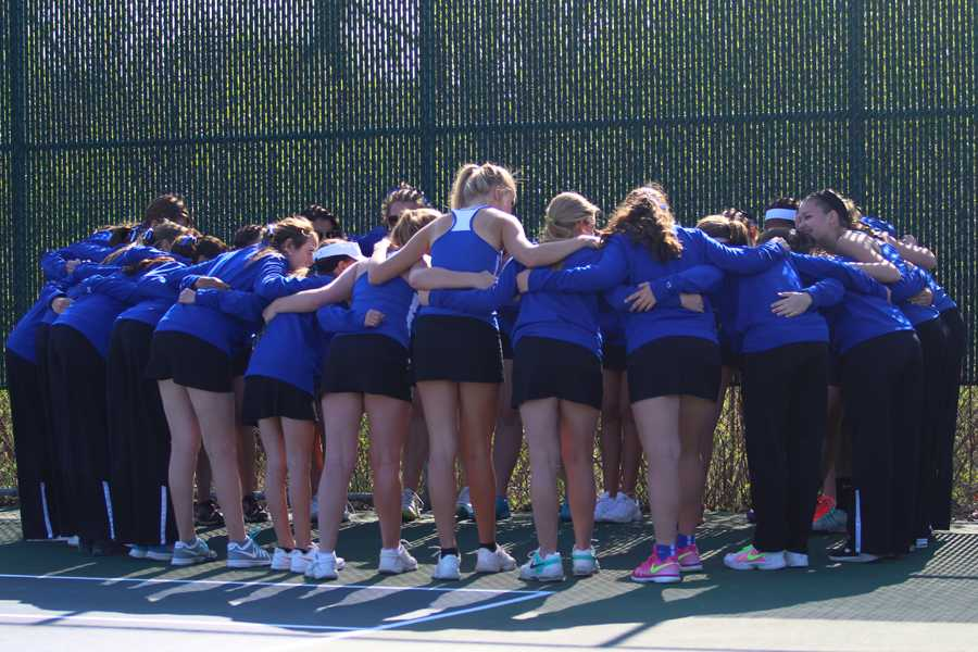 The+team+huddles+before+their+big+game+against+the+Valparaiso+Vikings+on+April+23.+The+girls+came+out+on+top+with+a+score+of+3-2.