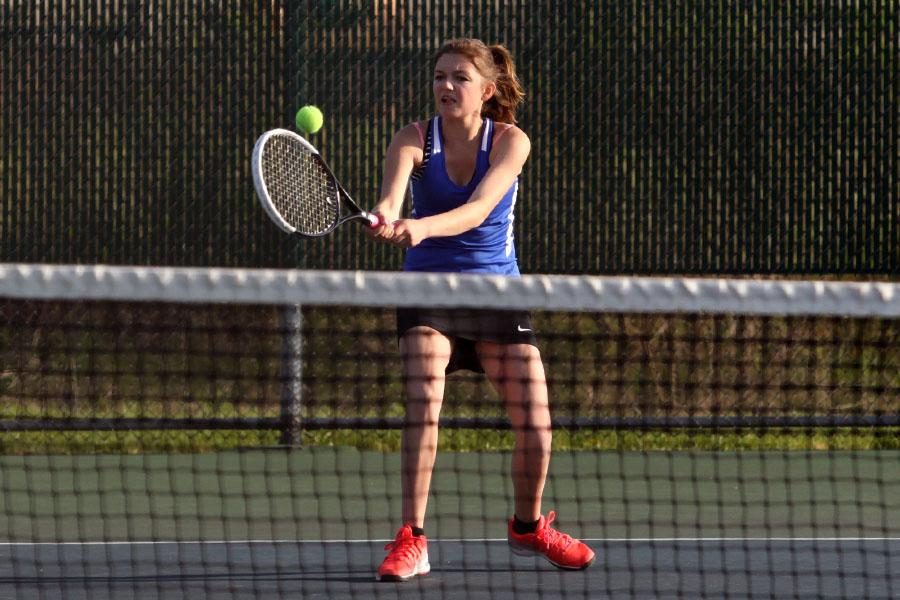 Lauren Gronek (10) hits the ball over the net.  Gronek played varsity No. 2 singles.