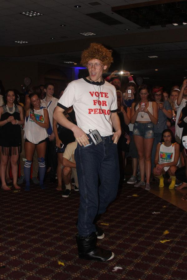 Nathan Zajac (12), dressed as Napoleon Dynamite, dances in front of the class of 2015. Zajac performed the original dance from Napoleon Dynamite.