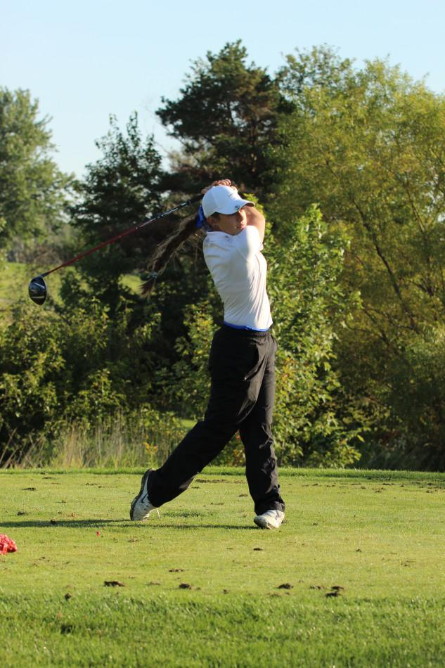 Alexis Miestowski (9) swings her golf club during Sectionals. The girls golf team qualified for State after this tournament. Photo By: Camryn Wallace