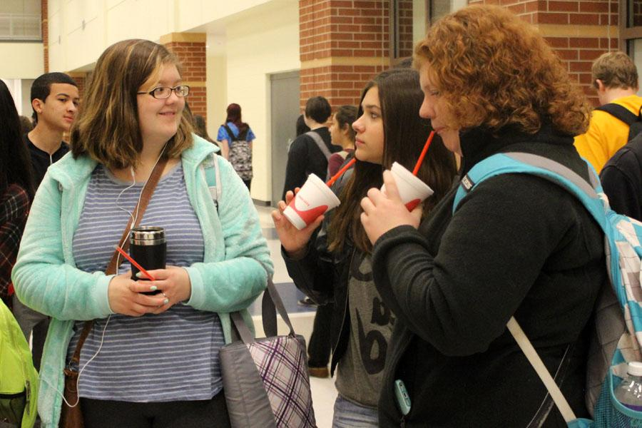 Kaitlyn Vander Laan (10), Christine Kutka (10) and Megan Kirby (10) sip smoothies before class. The fundraiser was put on through Smoothie King.