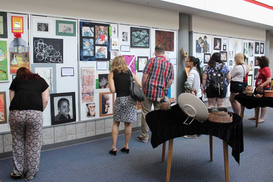 Spectators+view+the+different+types+of+art.++Many+Lake+Central+alumni+were+in+attendance.