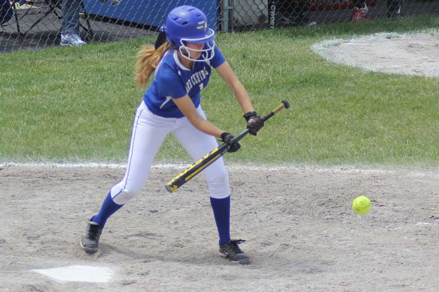 Ashley Nylen (12) bunts the ball.  The girls ended the first inning two runs ahead of Lowell.