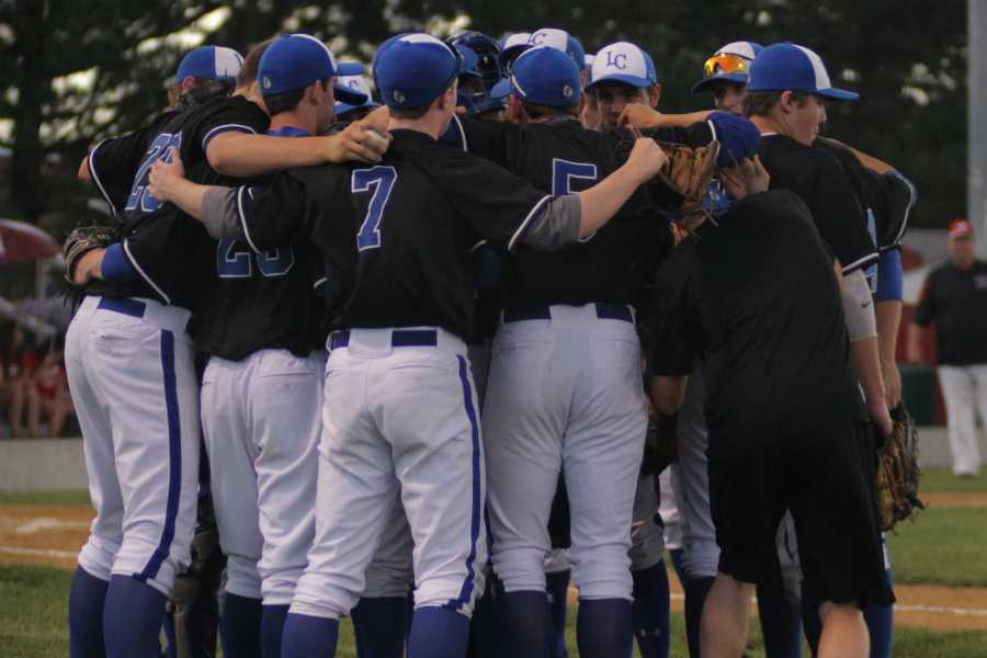 The varsity baseball team huddles before the game against Munster Friday, May 29. The team beat the Mustangs with a final score of 5-3.
