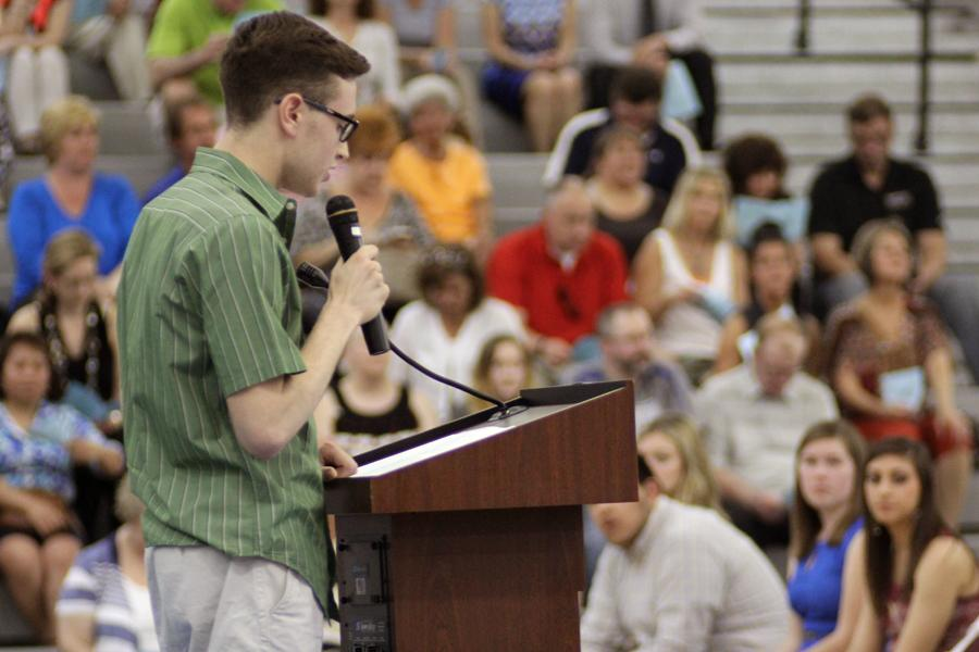Current National Honor Society Vice President Nicholas Kiepura (12) gives a speech to new NHS members. At the end of the induction ceremony new officers were announced.