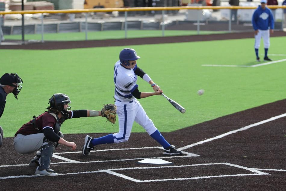 Colin+Studer+%2811%29+makes+contact+with+the+ball.+Studer+served+as+an+outfielder+for+the+Tribe.