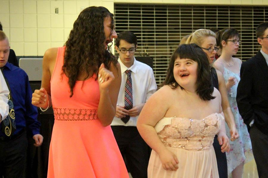Renn Arvanitis (11) and Olivia Zlatic (11) dance side by side on the dance floor. Those who attended the event came dressed in formal wear.