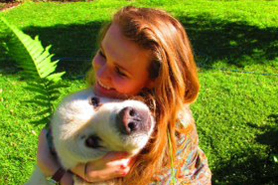 Natalia+Kuzbiel+%2811%29+embraces+her+dog+Buddy.+Along+with+having+a+pet+dog%2C+Kuzbiel+also+owns+chickens%2C+goats+and+turkeys.