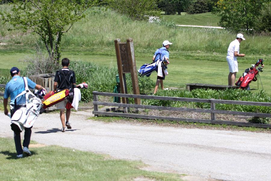 Golfers from various schools walk to par 6. Many golfers said this was the hardest hole.