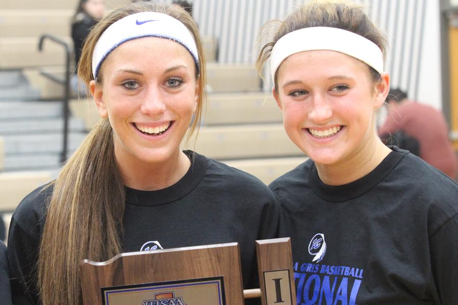 Gina Rubino(12) and Tara Zlotkowski(12) hold the 4A Sectional Championship trophy. Rubino and Zlotkowski made plans to continue their basketball careers together at Indiana University Northwest. Photo by: James Lafakis (12)